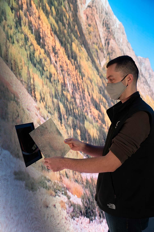 E&S technician examines a DomeX LED Dome panel