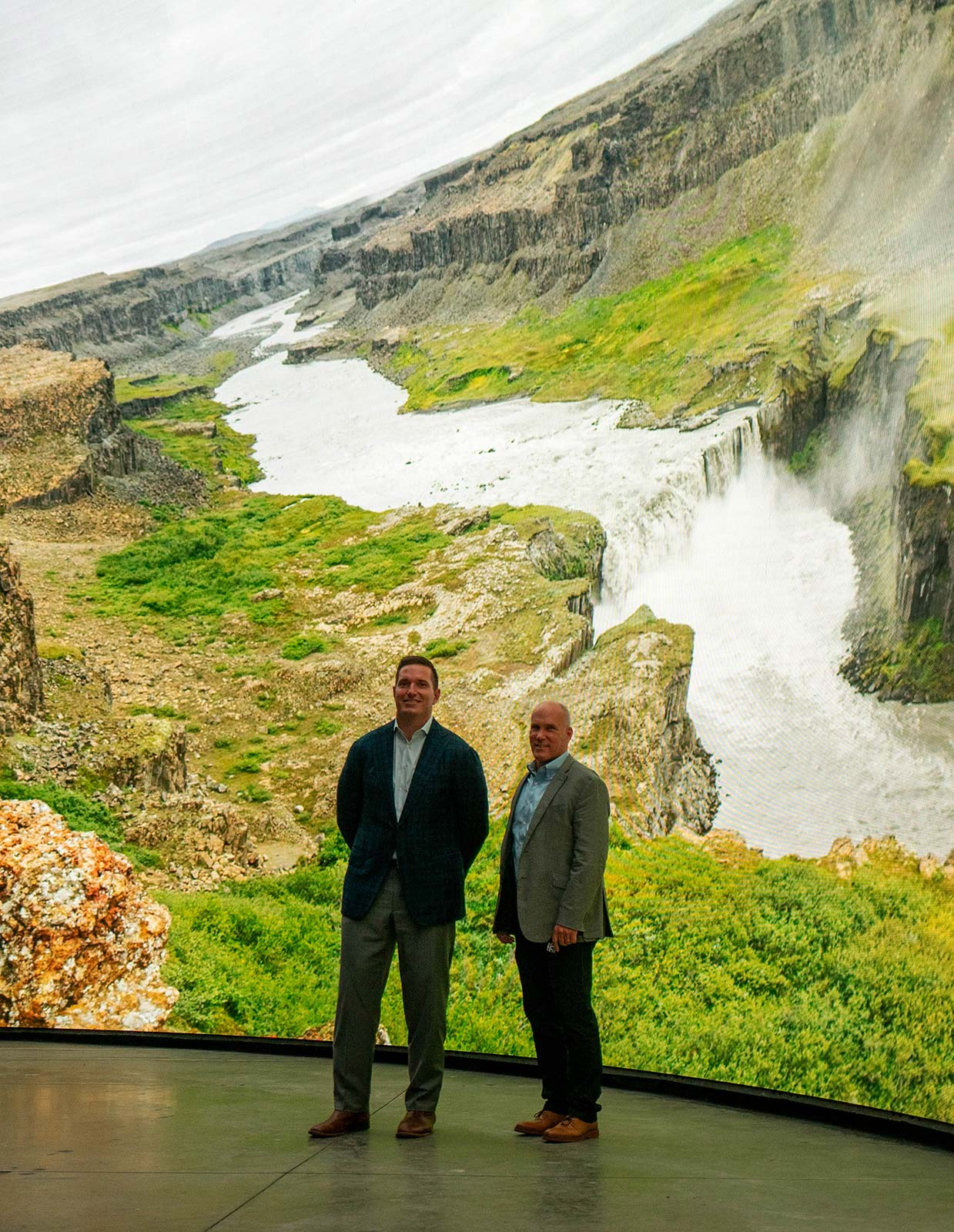 E&S Executive Vice President & General Manager Kirk Johnson with Cosm CEO Jeb Terry in front of DomeX immersive LED dome at the Cosm Experience Center